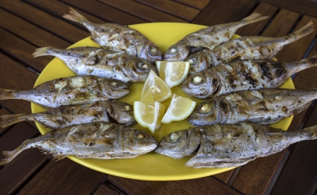 Barbecue fresh fishes with lemon