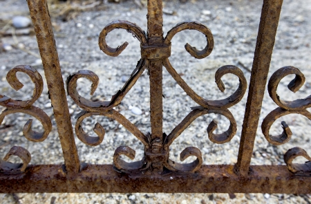 A railing eaten away with rust Stock Photo
