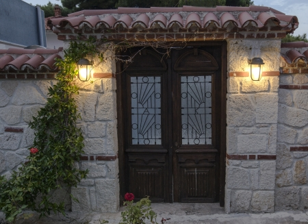 A gate with flowers and light