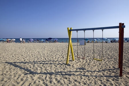 Baby swing at a beach in Greece