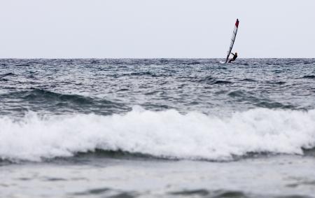 A windsurfer in a sea photo