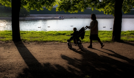 A woman with baby walk in a park Stock Photo
