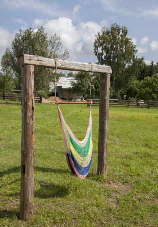 A coloured hammock hanging in the garden Stock Photo