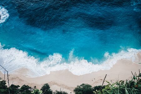 Wild beach, top view, ocean waves