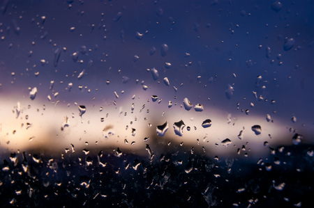 On a wet glass, drops of water are clearly visible in the evening Banco de Imagens