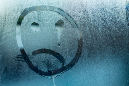 image of a crying face on a glass Stok Fotoğraf