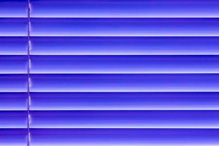 blue horizontal blinds on the window create a rhythm