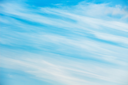 a sky with unusual clouds in the form of diagonal stripes, can serve as a background or an insert into the landscape. Stock Photo