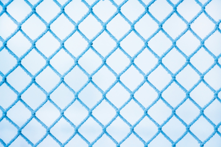 winter, a grid of fence, covered with hoarfrost, a frosty winter day Stock Photo