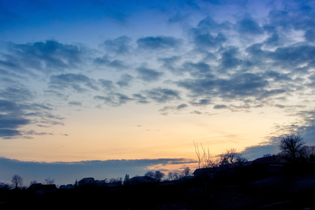 landscape, sunset or sunrise, the sky covered with picturesque clouds Stock Photo