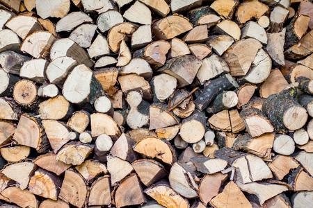 neatly stacked firewood, fuel in the cold winter, a pattern for creativity