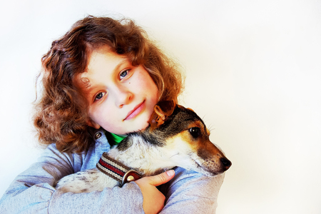 girl holds a puppy in her arms, cares for animals, an expression of love for pets