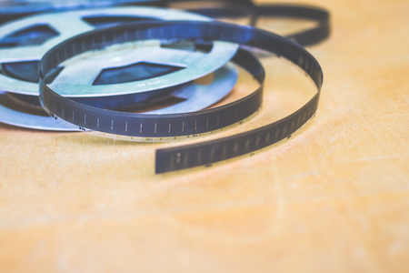 object of antiquity:  reel with an old film, shot on  film, from  collection of retro