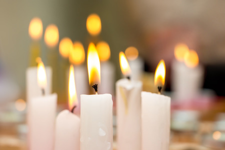 burning candles in  church during worship, observance of religious traditions and rituals