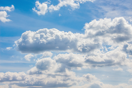 White clouds on  background of  blue sky on  clear, bright day
