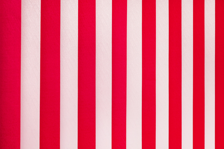 Texture of white and red stripes. Vertical blinds on  window Stockfoto