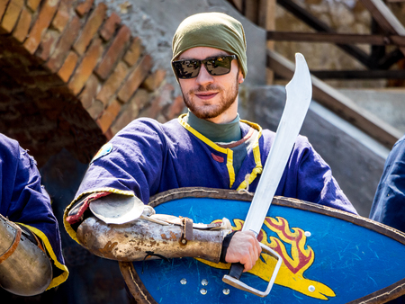 Ukraine. Staroskonstantinov August 2018. A man wearing a medieval warrior at a festival of ancient culture Éditoriale
