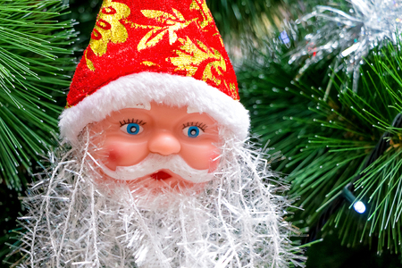 Mask of Santa Claus  on Christmas trees during New Year holidays