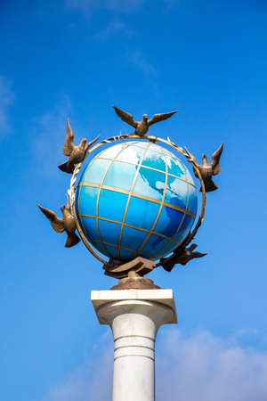 A fragment of the sculpture is a zero kilometer in Kiev on Independence Square. Earth globe and pigeons around it, a symbol of peace Stock Photo