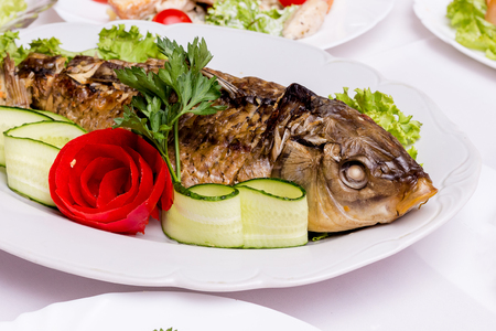 Stuffed fish at the restaurant's festive table