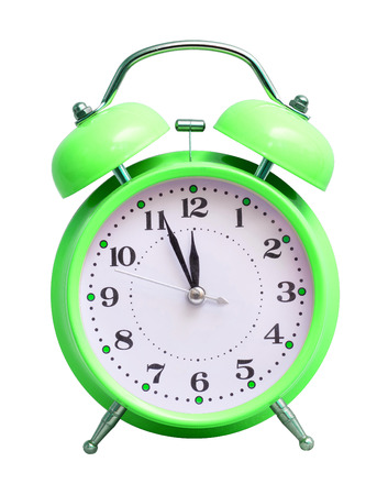 Green clock on white isolated background, which shows the approximate 12 hours. The New Year is coming Imagens