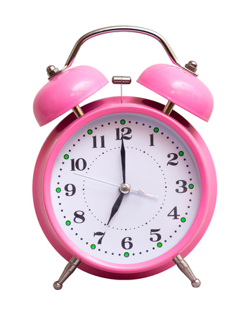 The pink clock on a white isolated background show 7 hour Stock Photo