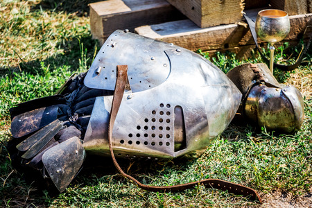 The helmet of a medieval warrior on earth after a knight's fight