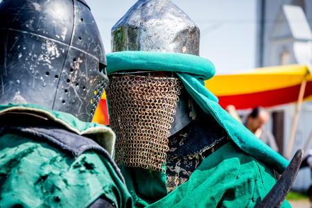Two knights in a combat armor before the battle close-up