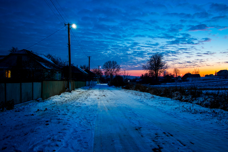 Rural street in the evening during the sunset 写真素材