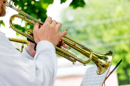 The musician plays the trumpet during an outdoor concert Stock Photo