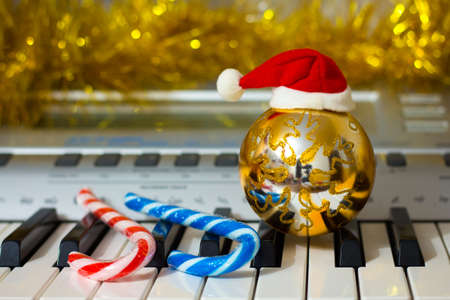 Christmas ornaments near the piano. Music on New Year's Eve