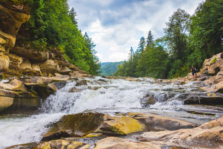 Mountain river with small waterfalls. Landscape with mountain river and trees, Yaremche, Ukraine