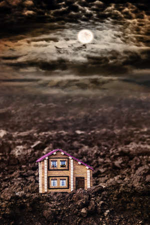 Lonely house in a field in the moonlit night. Life outside of civilization. Development of new lands. The first new building