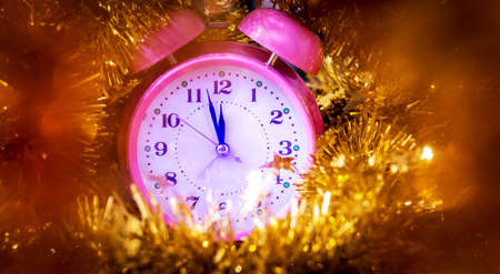 The clock among the Christmas decorations shows the approach of the new year 版權商用圖片