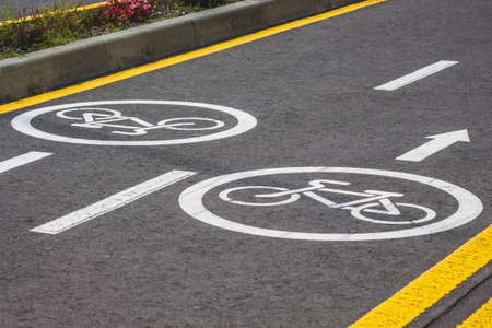 Bicycle asphalt track with markings in a modern European resort