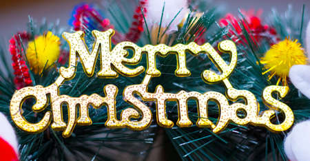 The inscription Merry Christmas on a background of Christmas wreath with decorations 版權商用圖片