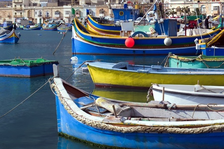 Colored Maltese boats harboured photo