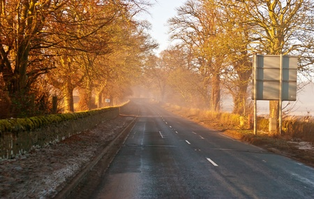 Country highway in Scotland vanishing in mystic  fog Stock Photo