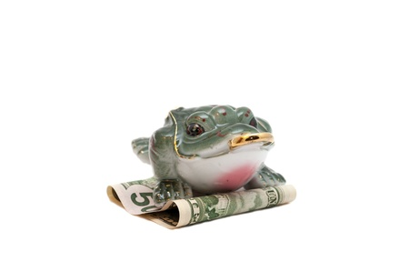 Frog - a symbol of fortune and success - sitting on a 50 US dollar note.