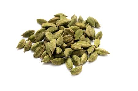 Cardamon seeds isolated on white background. Close-up. Stock Photo