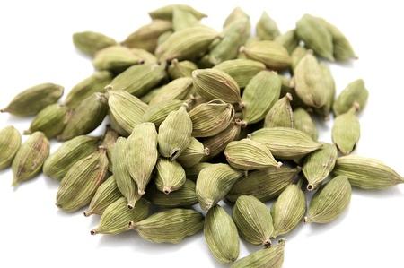 Cardamon seeds isolated on white background. Close-up. Stock Photo - 12045055
