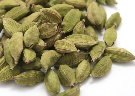 Cardamon seeds isolated on white background. Close-up. Stock Photo
