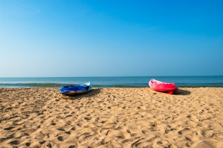 Colorful boats on the Palolem beach, Goa, India photo