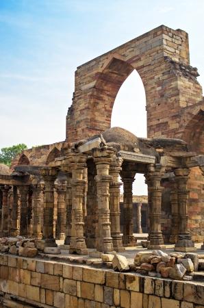 minar: Iron Pillar and Qutab Minar Ruins Delhi India Stock Photo