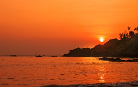 Stunning Sunset at beach in Goa, India photo
