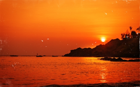 Stunning Sunset at beach in Goa, India. Old retro photo style photo