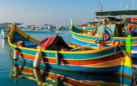 Colored Fishing boats in  Marsaxlokk harbor, Malta Stock Photo