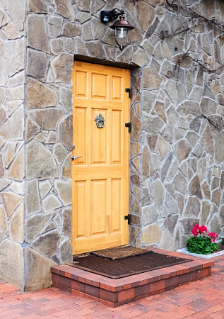 Wooden door  on stone wall. photo