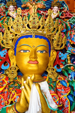 future buddha: close up side view of maitreya Buddha sculpture in a monastery in  India