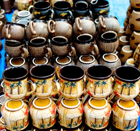 parallelism: Ceramic cups in Stock selling in a market